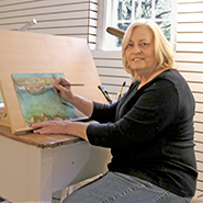 Kathleen Horst at her painting table
